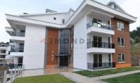FE-122, Distant view real estate with pool and balcony in Fethiye