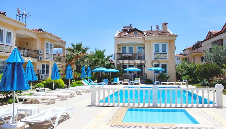 Distant view apartment with balcony and pool in Fethiye